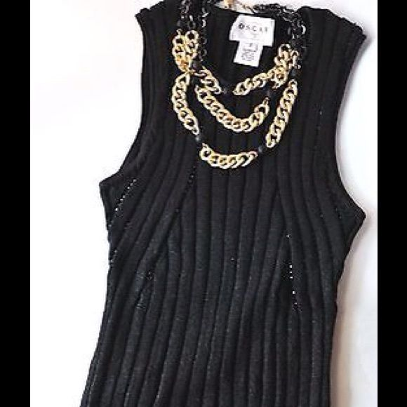 ÓSCAR DE LA RENTA Knit TOP Black beaded sleeveless Stylizing, and fitted to kill top by OSCAR DE LA RENTA  Medium Weight Knit for a minimalist take on elegance.  With black beads vertically distributed across upper front section Round neck Small Composition 80% Rayon, 20% Nylon. Can be paired with literally anything, a solid staple for your posh closet. NECKLACE IS not included on this listing. Oscar de la Renta Tops Tank Tops