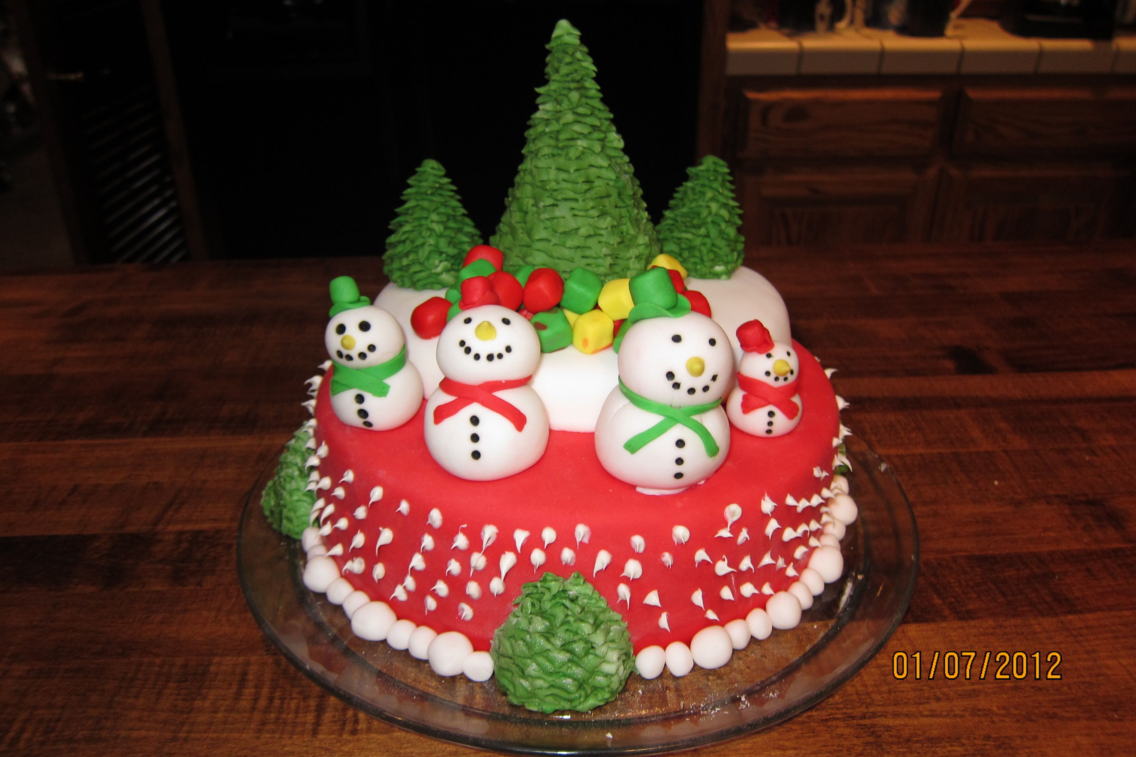 Winter Wonderland Cake - This was a 2 layer cake (3 layer in some places) The first layer was yellow and the second layer was choclate. The cake is covered in fondant and all of the decorations that you see on the cake are made out of fondant. :)