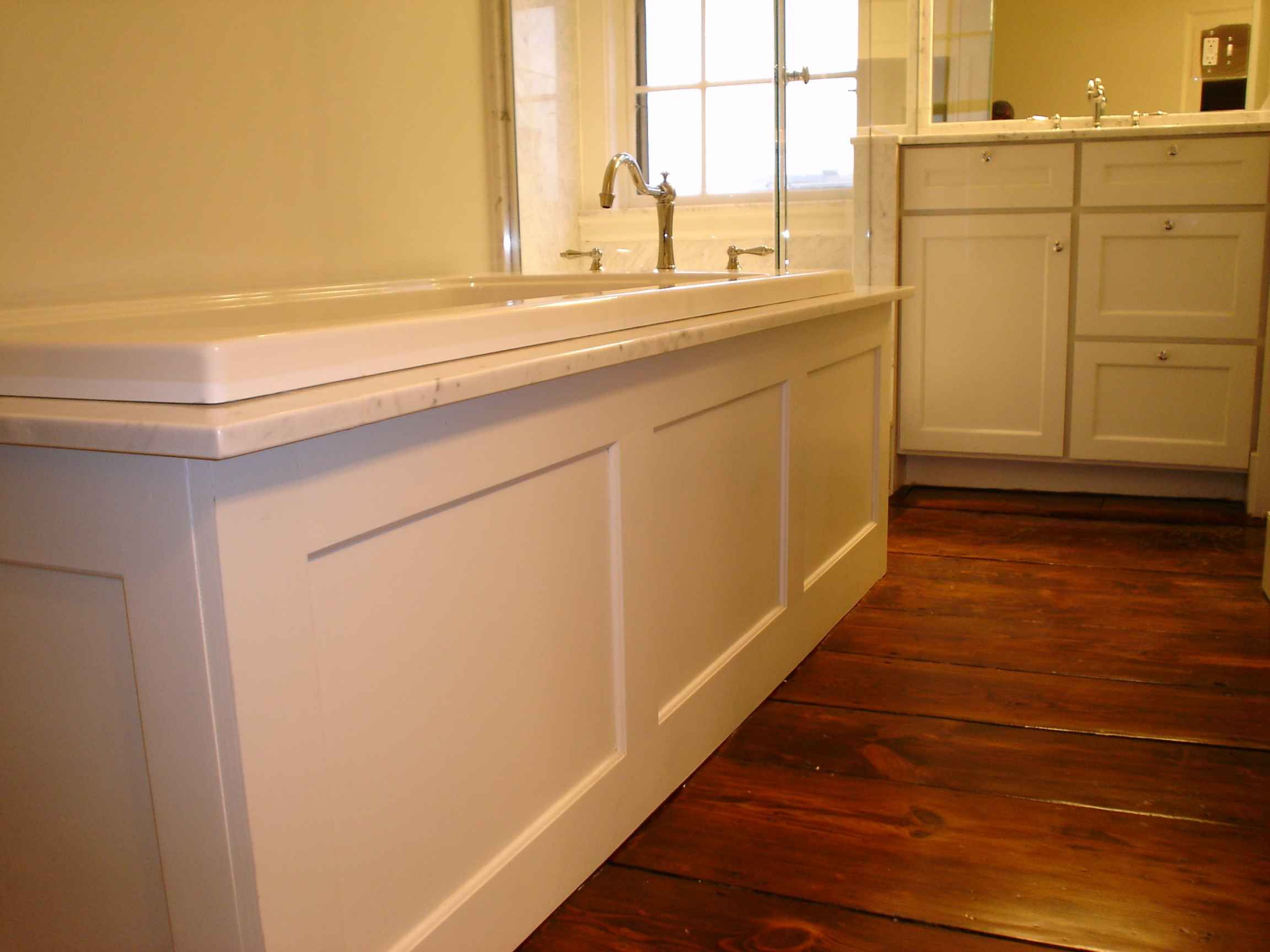 Private residence in british colonial style traditional bathroom - Wood Tub Surround Paint Or Stain To Match Vanity