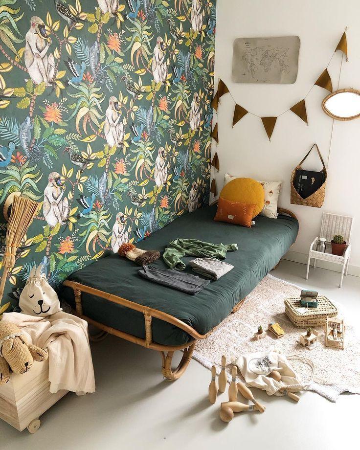Adorable big kid's room with creativityinducing wallpaper