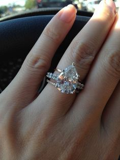I'm in love... pear shaped diamond wedding ring, with stackable mismatched bands. Very trendy, vintage with a modern twist.
