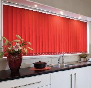 red verticals in a muted kitchen
