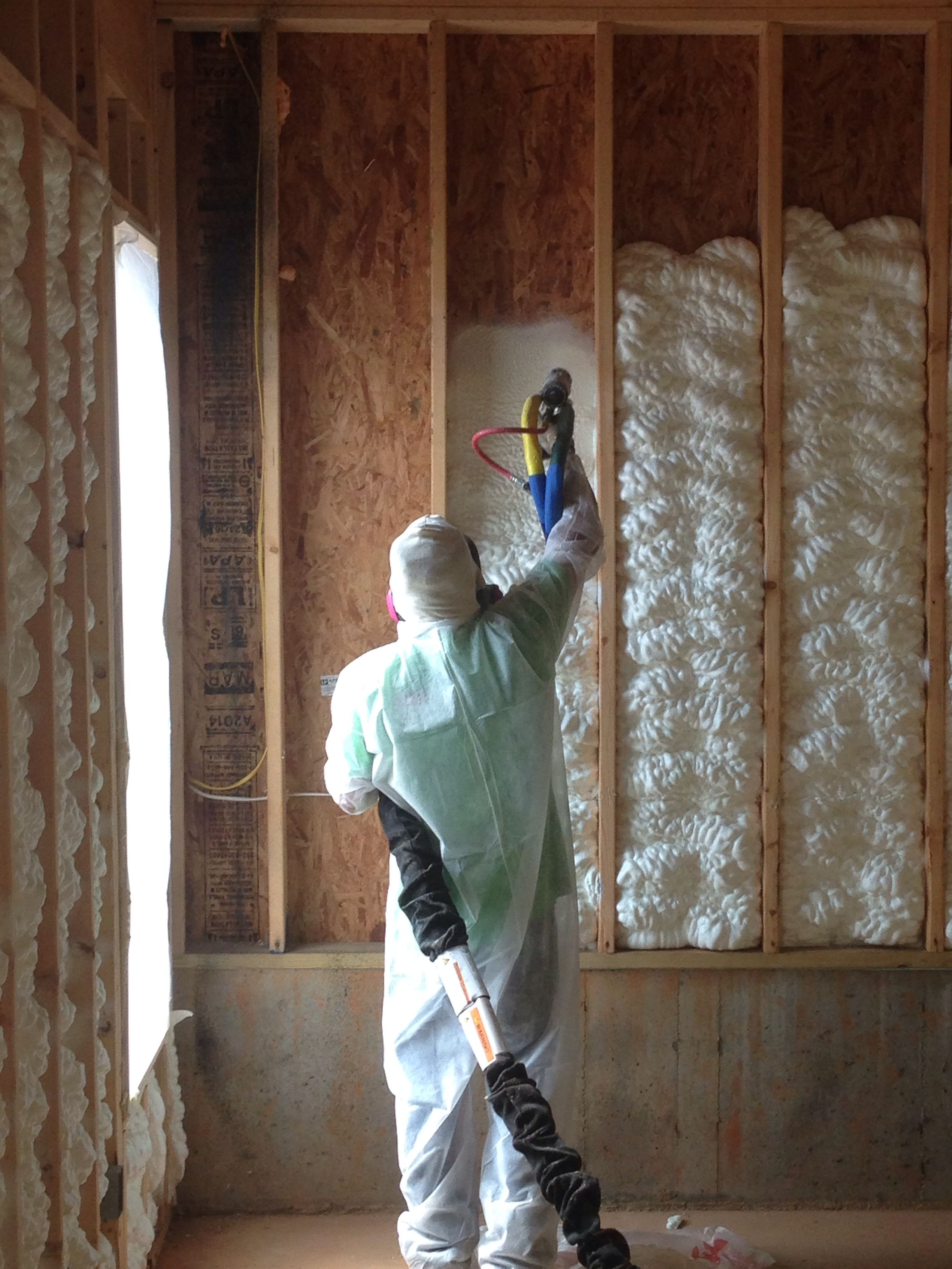 Open Cell Spray Foam Insulation Being Installed Into Exterior