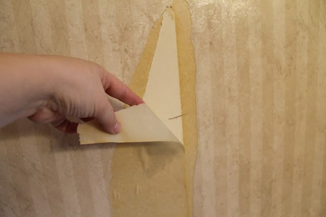 How to remove old wallpaper easily: warm water & fabric softener