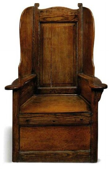 A GEORGE II FIGURED ASH, ELM AND OAK WING ARMCHAIR  EARLY 18TH CENTURY  WITH FLATTENED ARMS, FIELDED PANEL-BACK AND SCROLL FINIALS  44½ IN. (113 CM.) HIGH; THE SEAT 15 IN. (38 CM.) HIGH