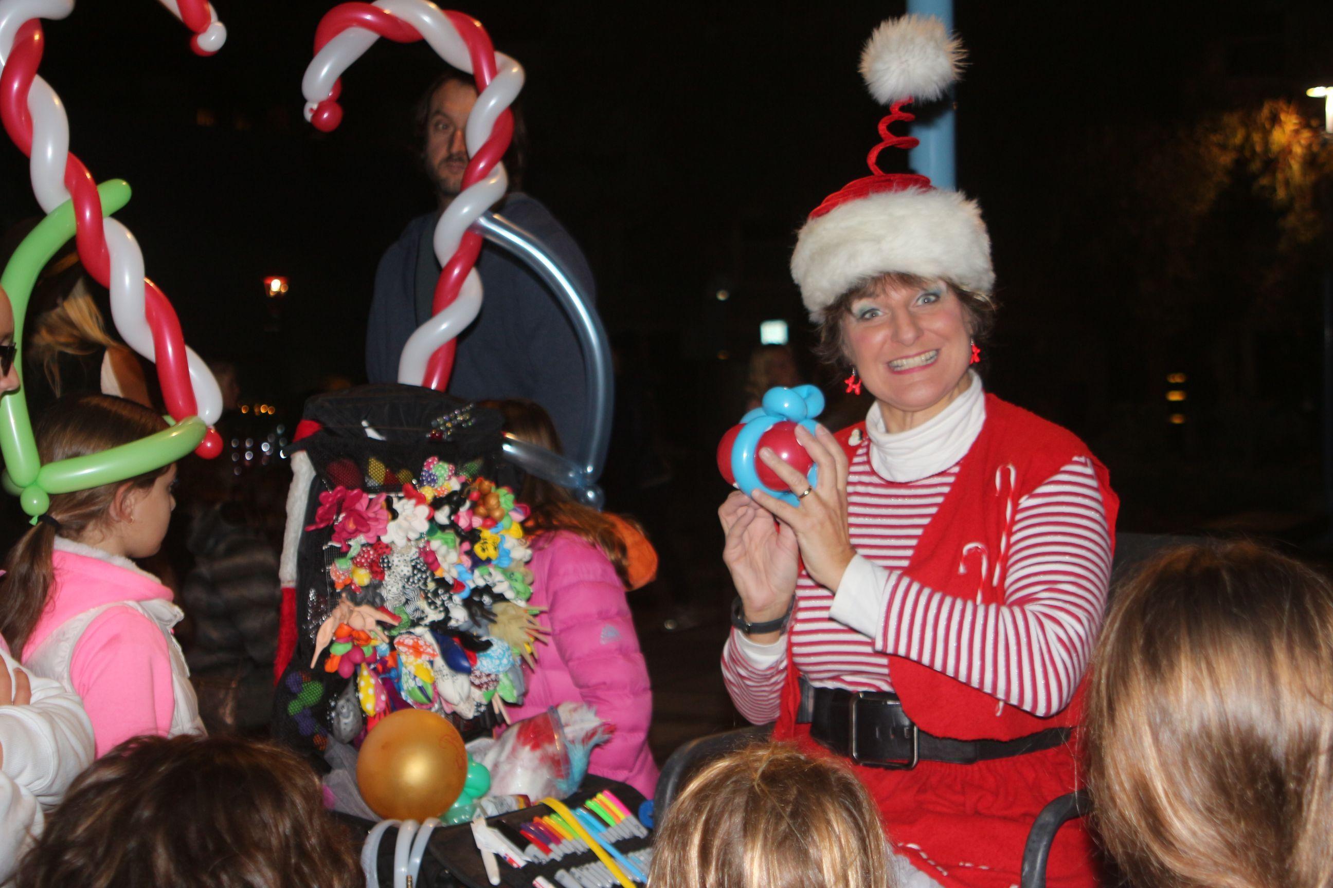 One of Santa's elves makes holiday balloon art