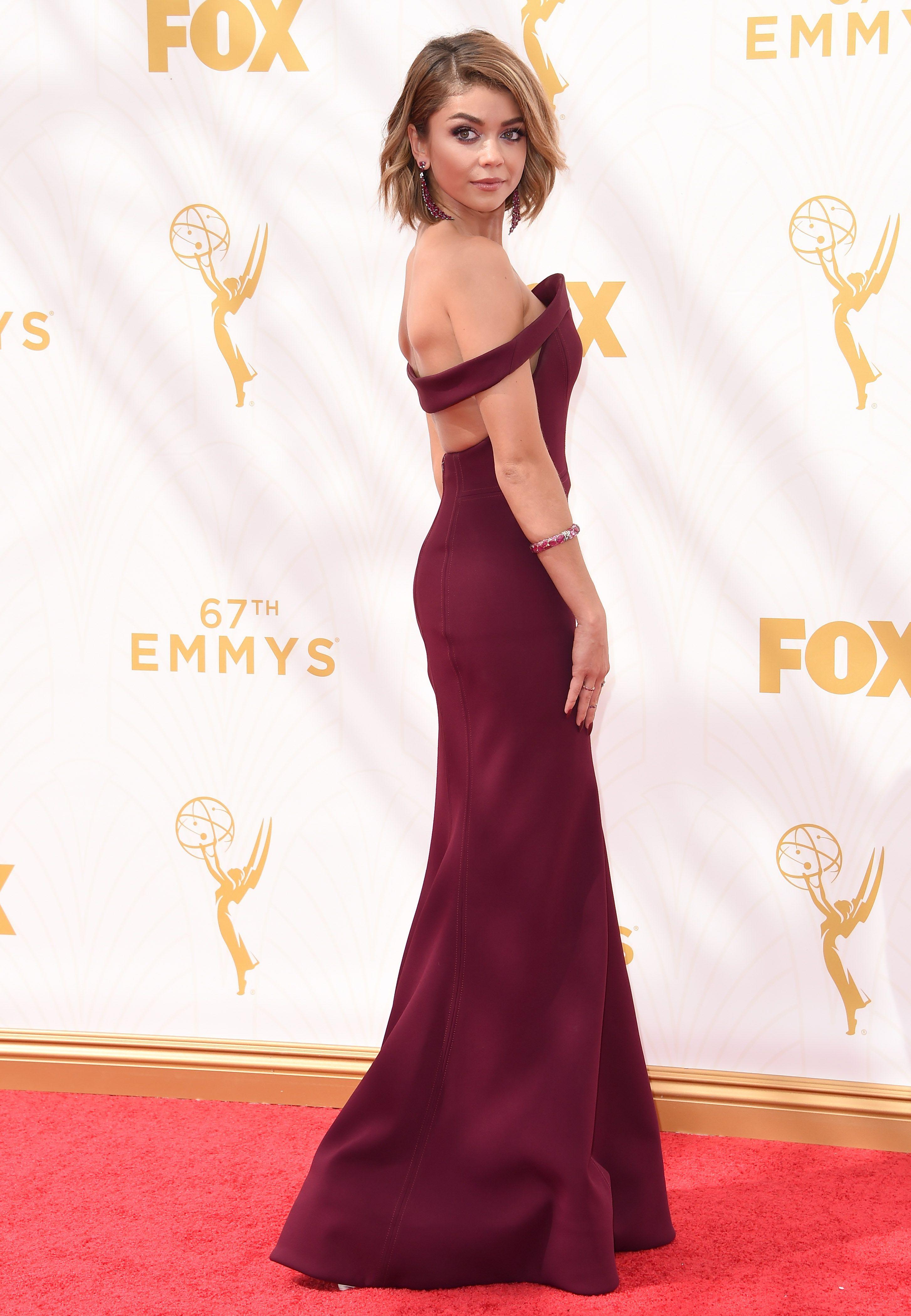 SARAH HYLAND IN ZAC POSEN Attending the 67th Annual Emmy Awards, September 20.