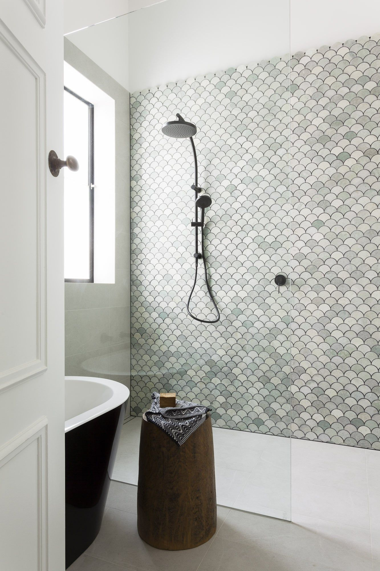 Beautiful bathroom makeover marble fan tiles petrina turner check out how a tile statement wall in your bathroom using cement tile natural stone or ceramic tile creates a fresh unique design dailygadgetfo Images