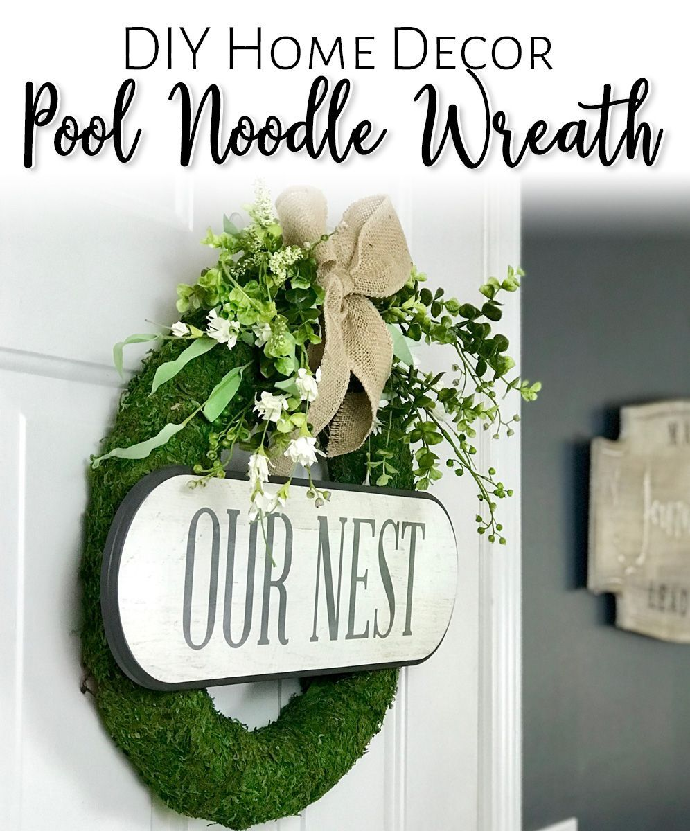 DIY Pool Noodle Moss Wreath #poolnoodlewreath Create a beautiful moss covered wreath for your home decor - using a pool noodle and some craft supplies from your stash! Easy to change out for the seasons as well! Video tutorial and supply list included!  #poolnoodle #diy #diyhomedecor #homedecor #wreath #diywreath #farmhousedecor #homedecordiy #farmhousediy #diyfarmhouse #diycraft #diycrafts #poolnoodlewreath