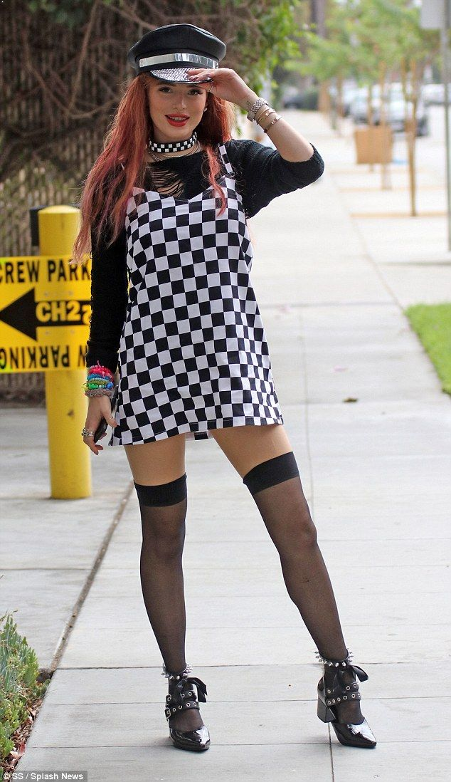87a58cd4418 Saucy look: Bella Thorne stepped out in LA Tuesday in a chequered pinafore  mini dress and black thigh high stockings