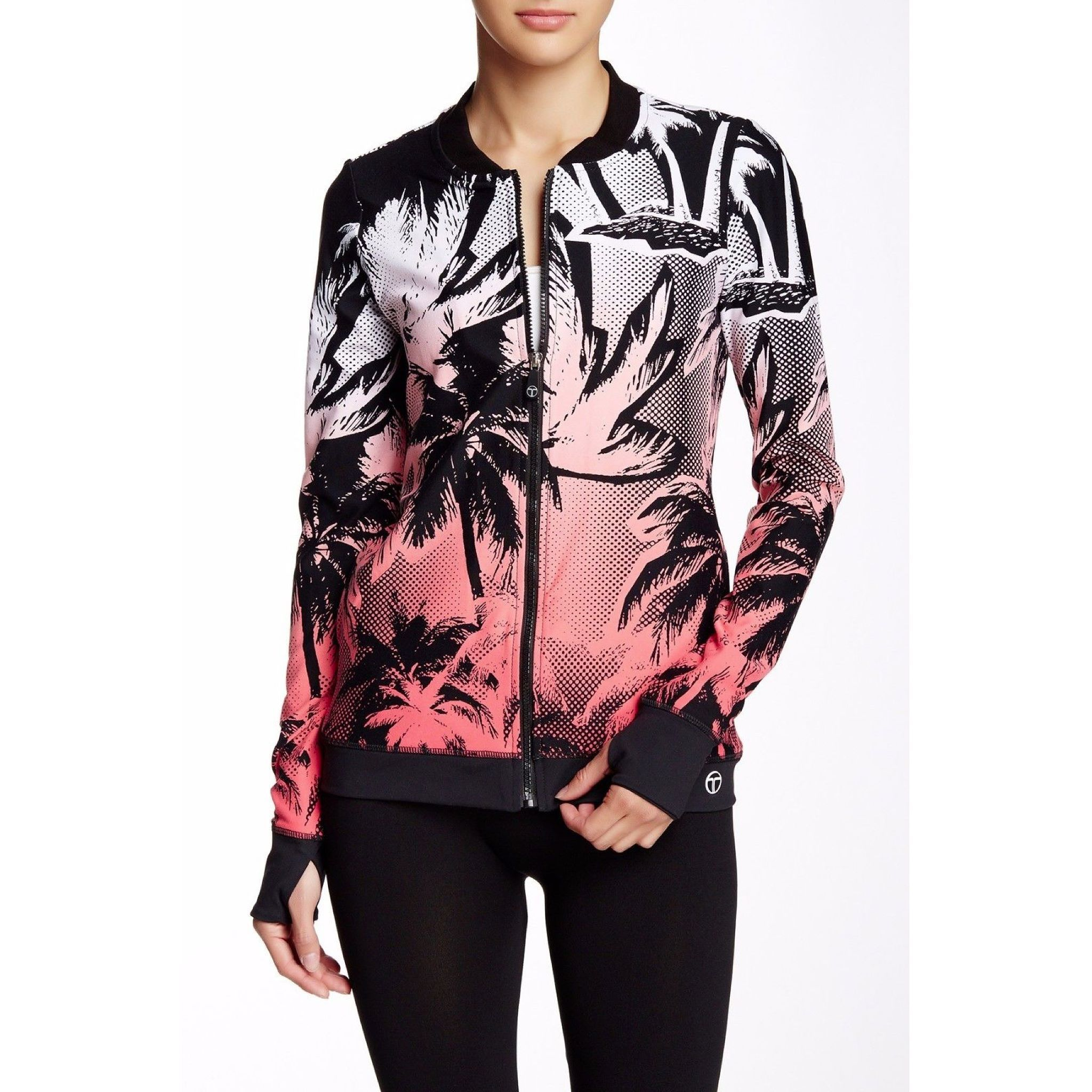 Youll never have to sacrifice style when you are running to and from the gym in this #trinaturk Palm Beach Bomber Jacket. With a cool ombre palm tree print and moisture wicking for comfortable wear its a piece youll wear wherever youre headed. Shop Link in Bio. #swankybazaar