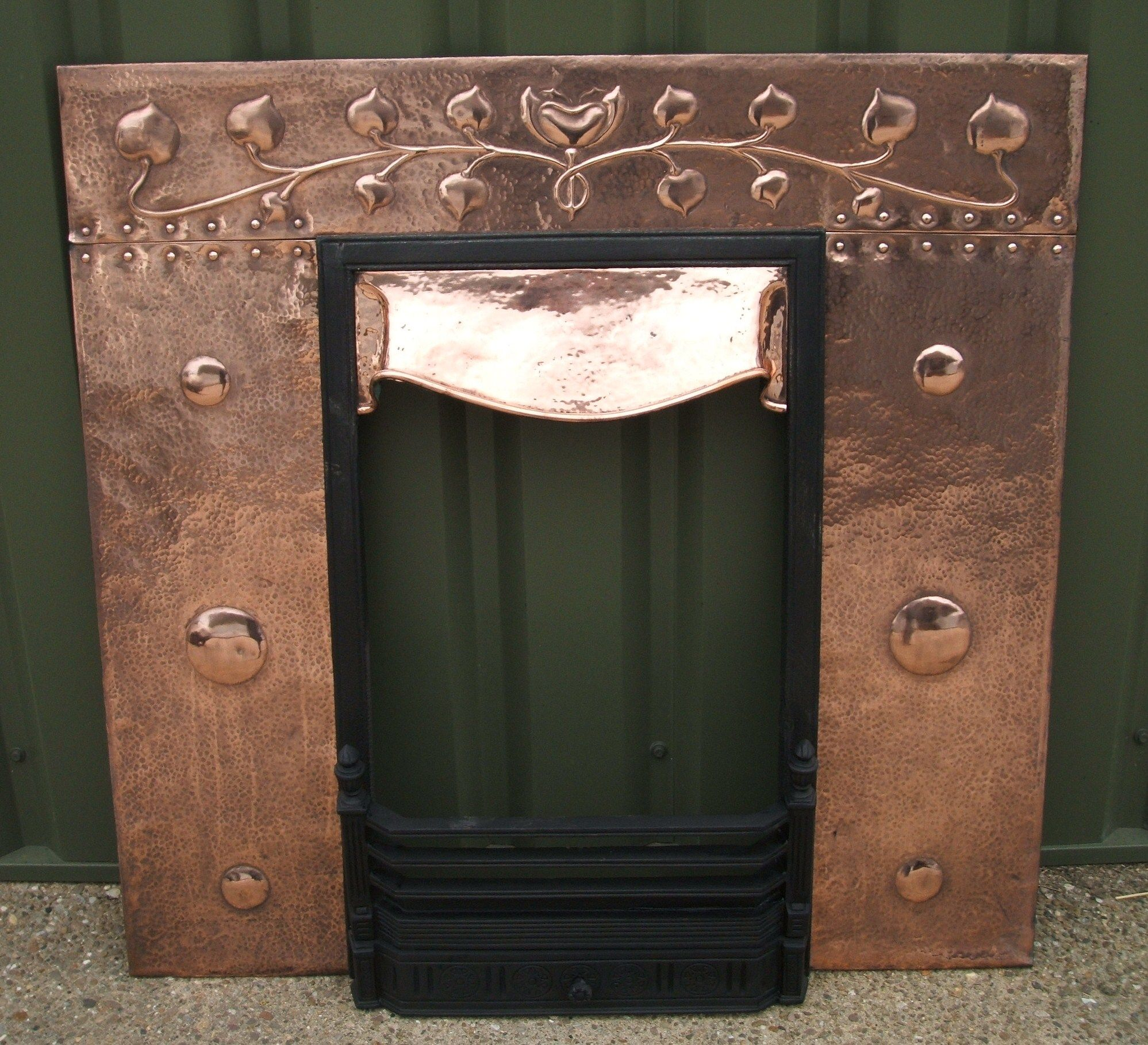 arts and crafts copper insert for a fireplace craftsman style