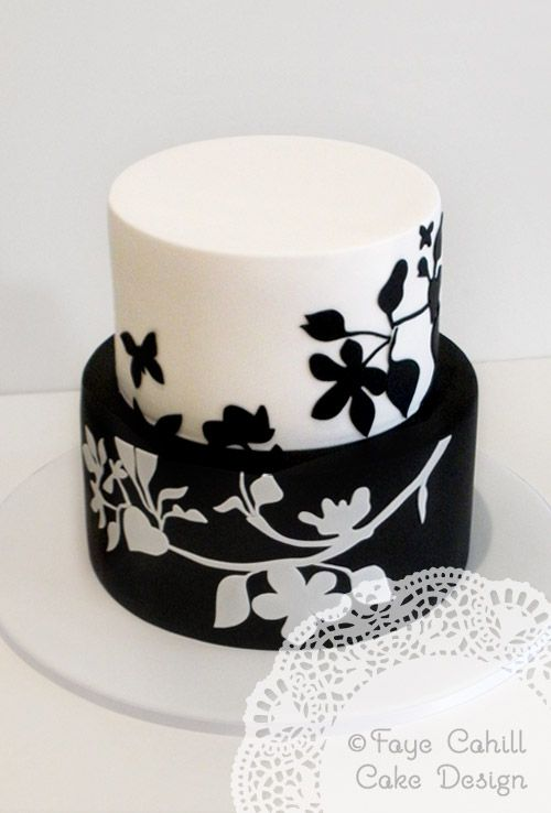 How classic and gorgeous.   The cake designer says it was created from the couples invitation.