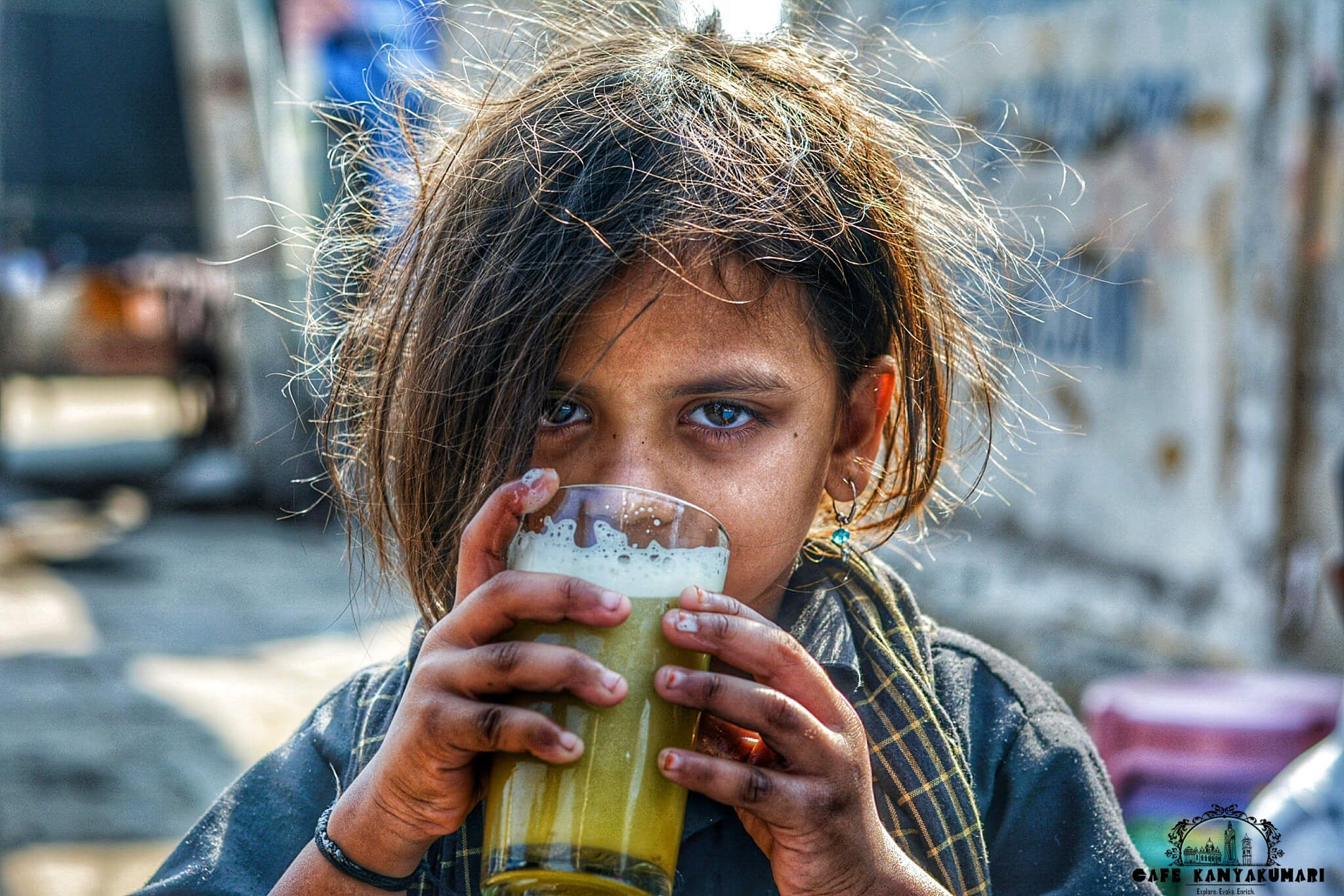 A Girl Having Her Fill Of Cool Sugarcane Crush