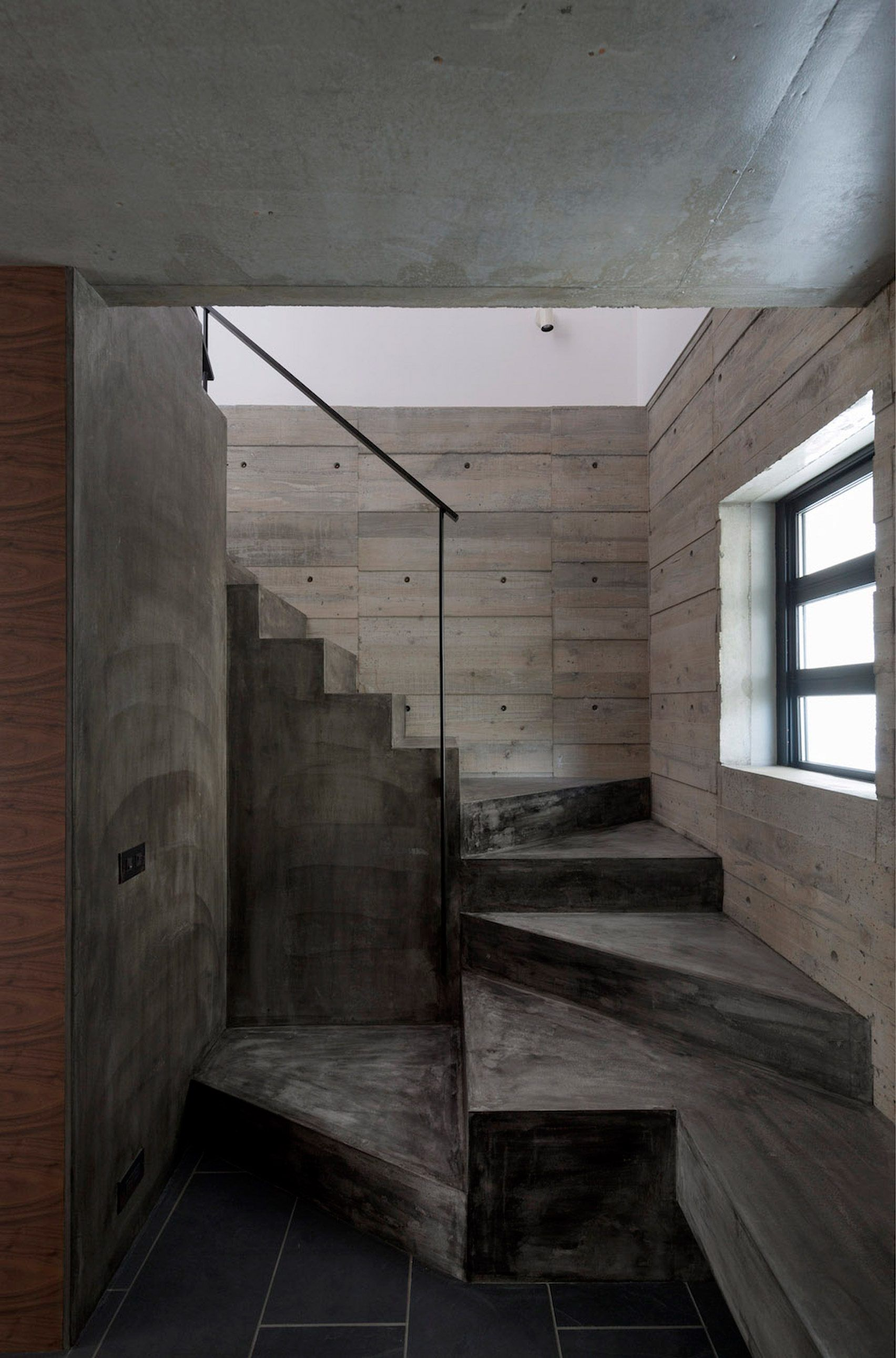 Cubo Design Architect Pairs Blackened Wood With Concrete For House