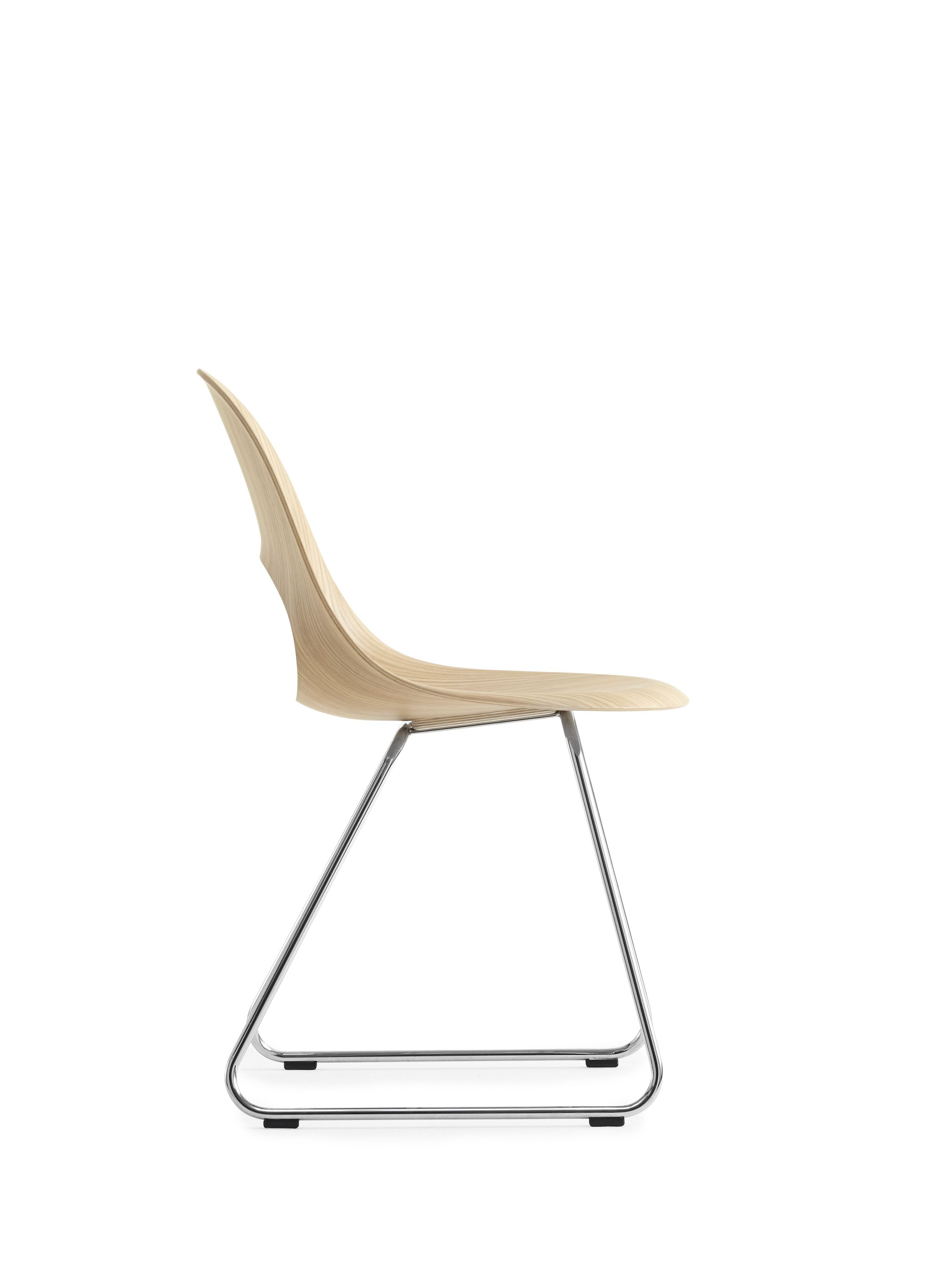 This beautiful SayO MiniLux Chair in raw wood with metal legs seen in profile. May be acquired with different types of wood veneer. Find out more at www.sayo.dk.