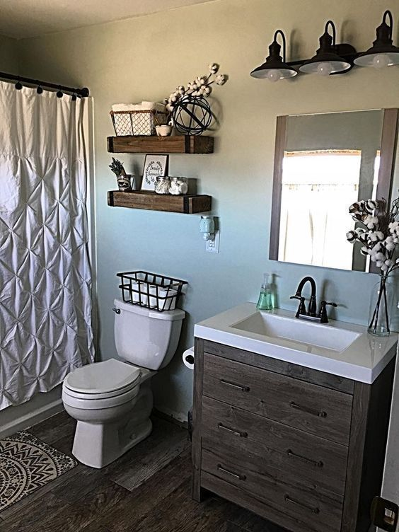 Photo of The bathroom in the farmhouse offers a few things that are more than just rustic and …