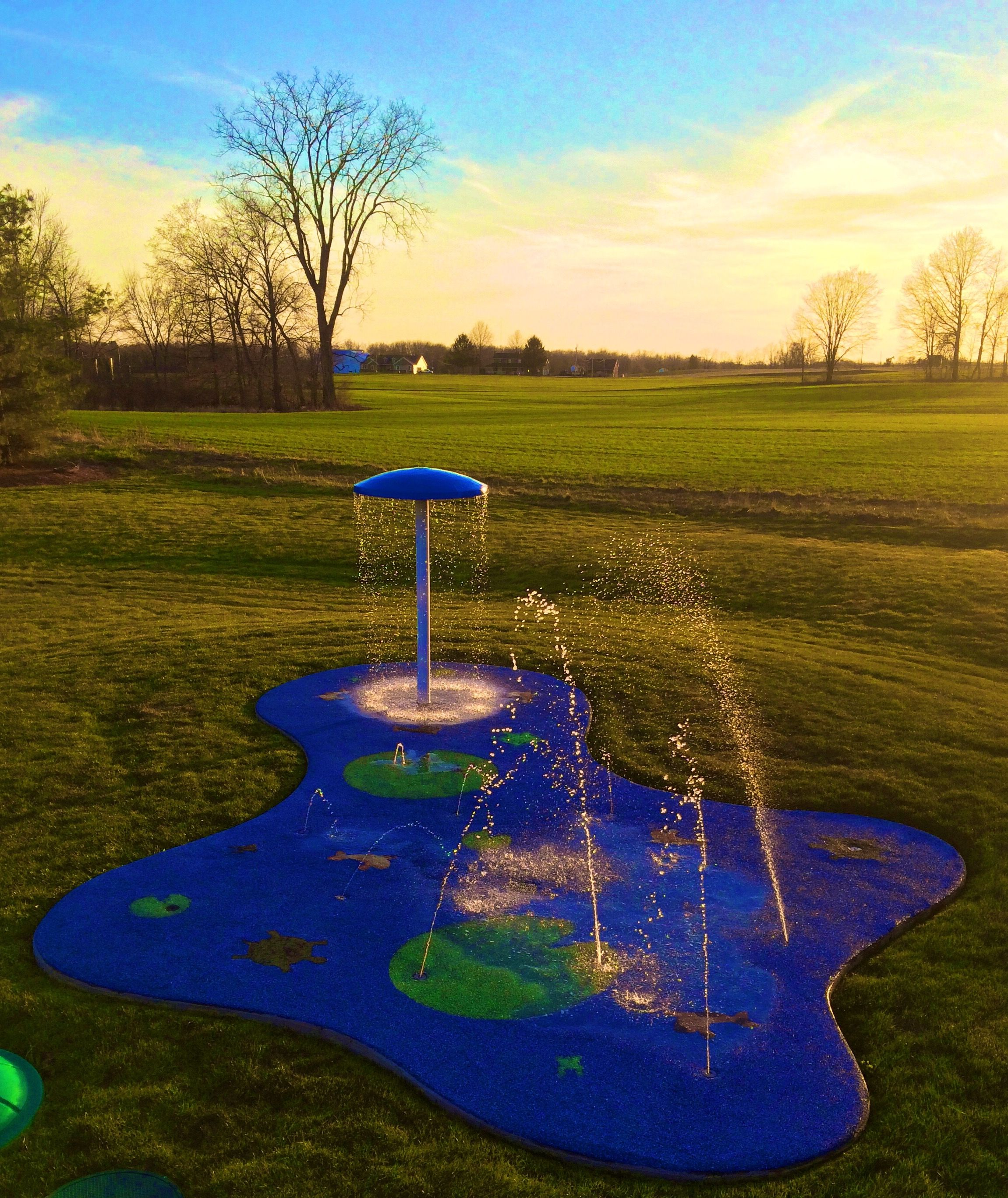 a home backyard splash pad is fun colorful and safe water play