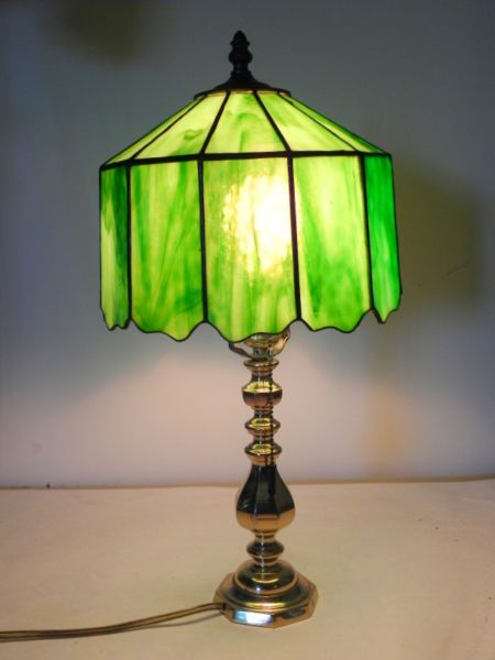 This lamp was made by a professional stained glass worker not from china overall height shade is high x 10 in diameter solid brass base located in blind