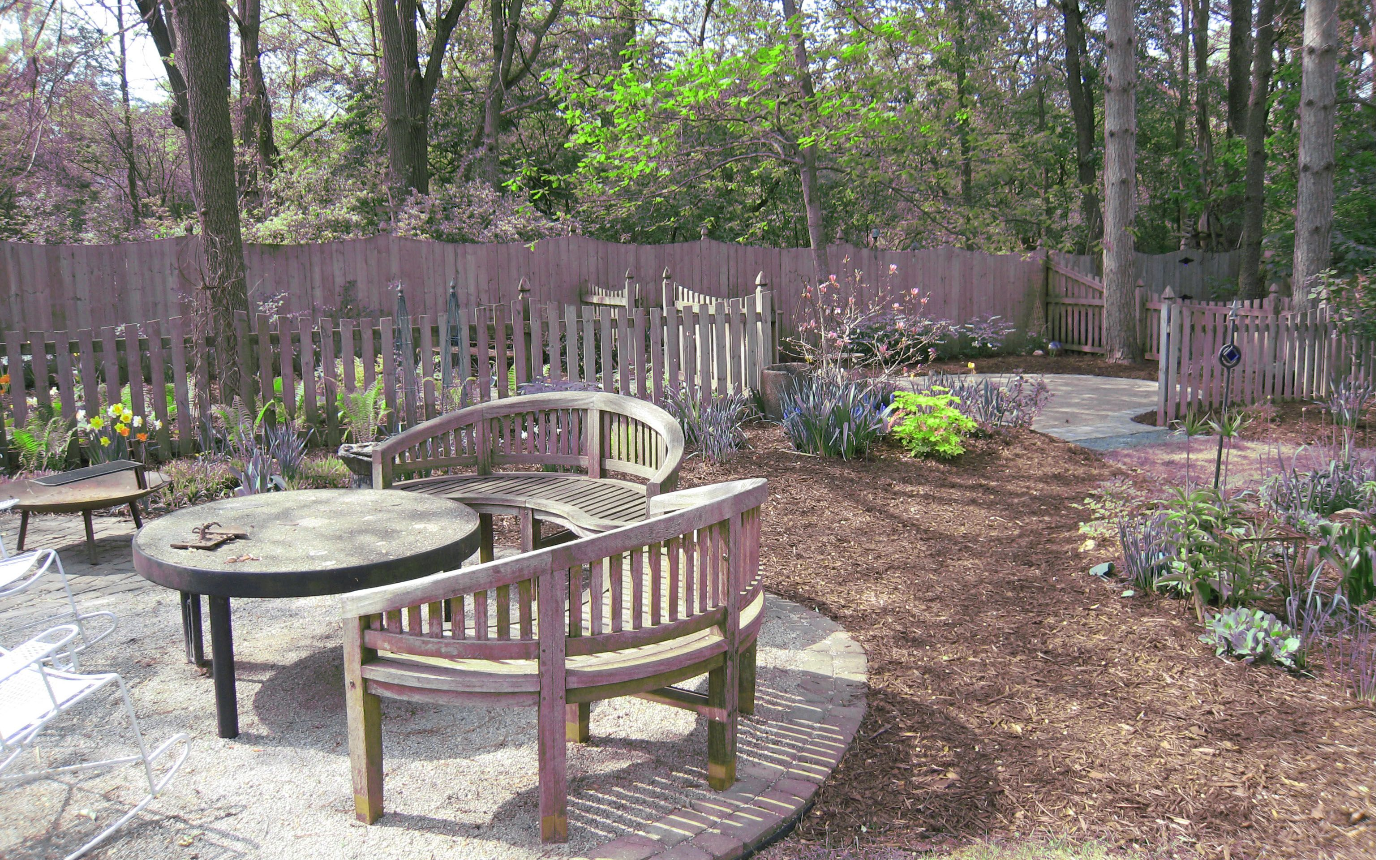 Patio Of Crushed Limestone Outlined In Pavers Makes For An Intimate Garden  Seating Area. Kim