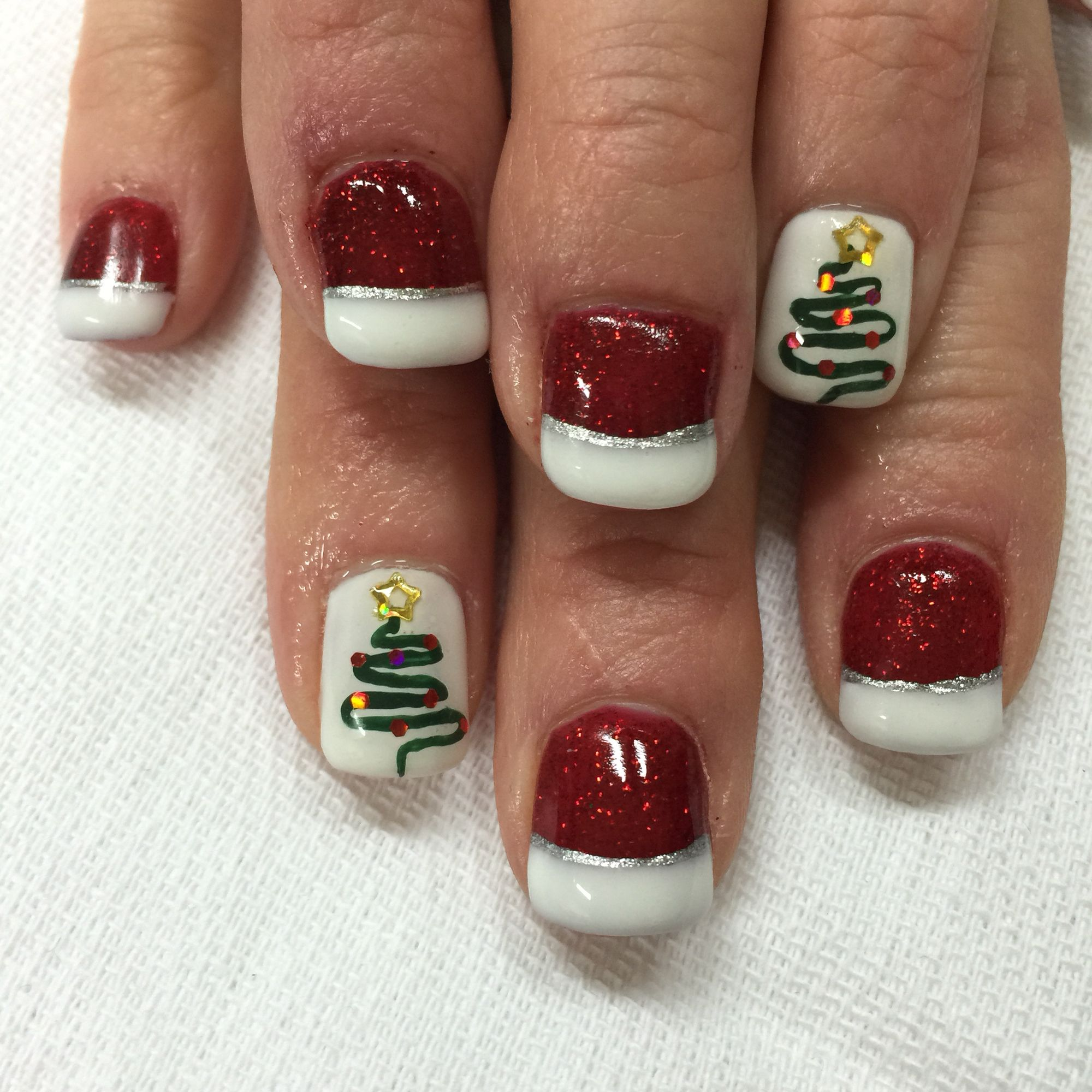 Red and white Christmas glittered French gel nails with tree accent ...