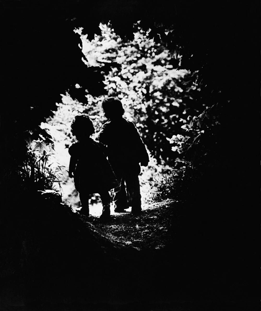 """Children of photographer W. Eugene Smith walk hand in hand in this iconic photo best known as: """"The Walk to Paradise Garden."""" (W. Eugene SmithThe LIFE Picture Collection/Getty Images) #tbt #throwbackthursday by life"""