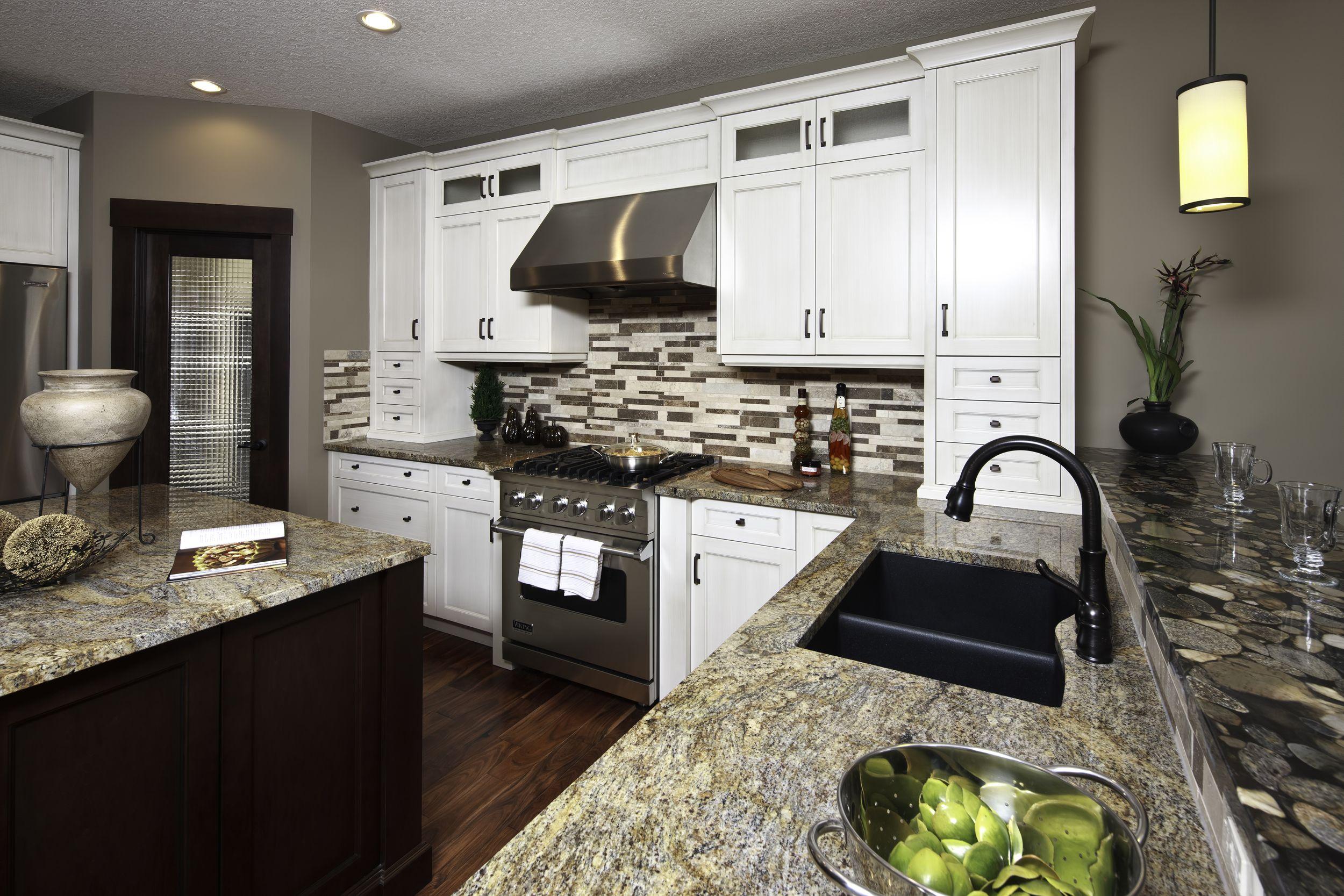 Kitchen alternate view of contrasting granite countertops