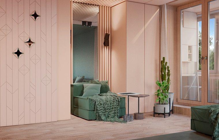 Arredamento soggiorno moderno design con un piccolo divano verde e ...