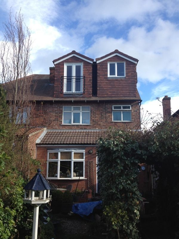 A Double Pitched Roof Dormer With Inset And Juliet Balcony