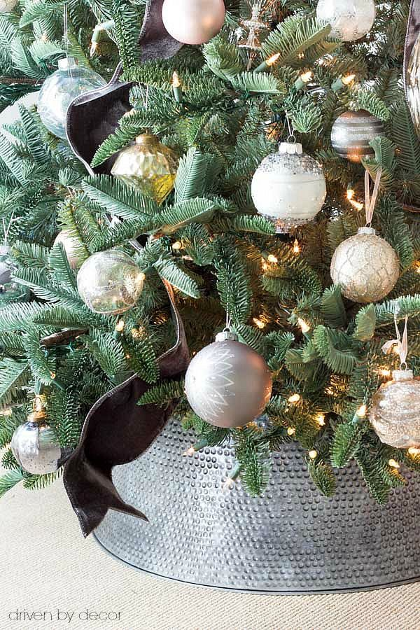 Love This Metal Tree Collar Used Instead Of A Traditional Christmas Tree Skirt Metal Tree Wall Art Metal Tree Traditional Christmas Tree Skirts