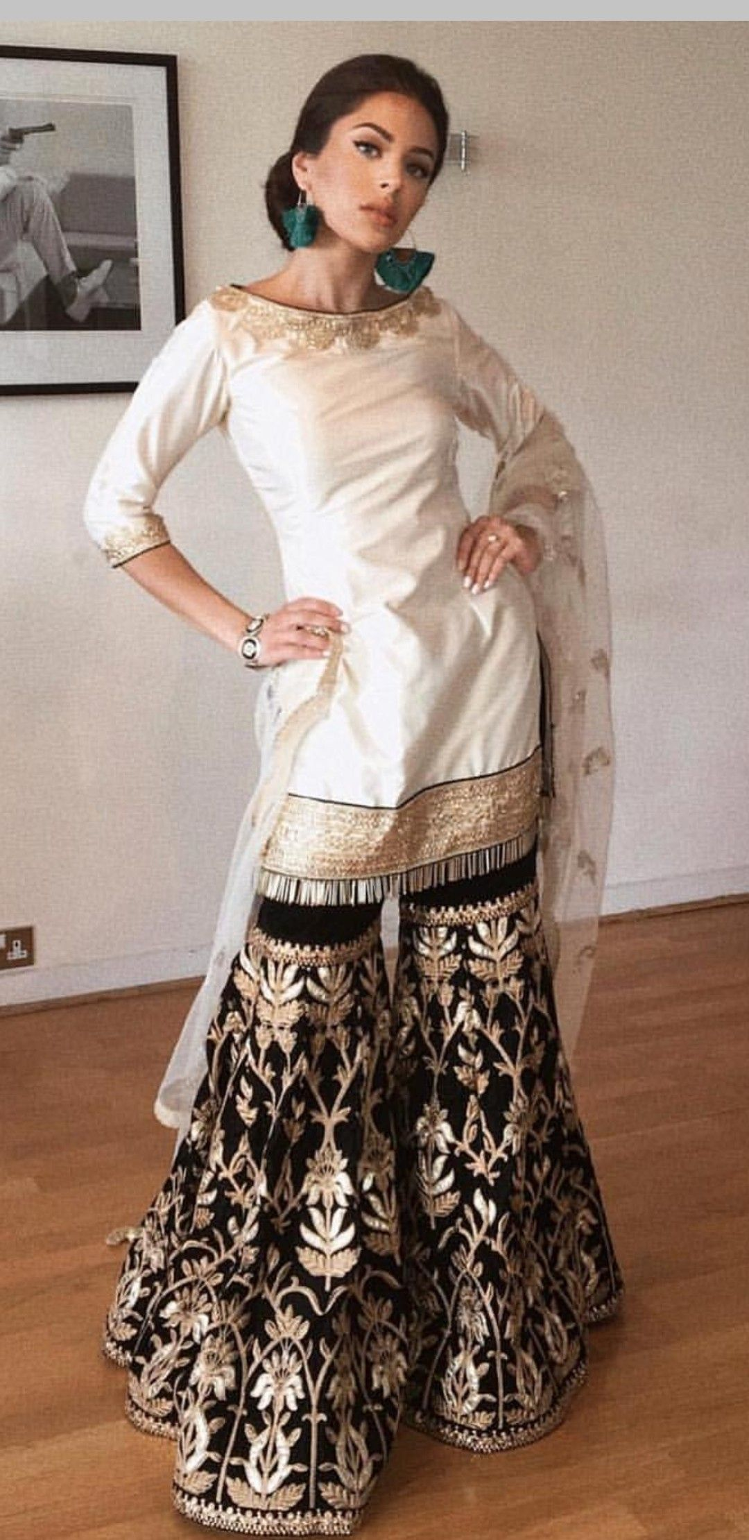 c6bb1a8a01 designer contrast white & black Salwar Suit with heavy embroidery on it. To  customised this garment log on to www.prasang.in