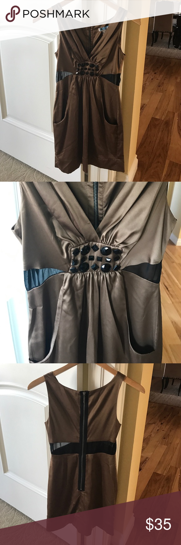 BCBG Generation Dress💇🏼 BCBG Generation Dress💇🏼. Sexy dress with black Sheer mess on sides and thru height waist in back, exposed zipper in back. Pockets. Great preowned condition BCBGeneration Dresses Mini