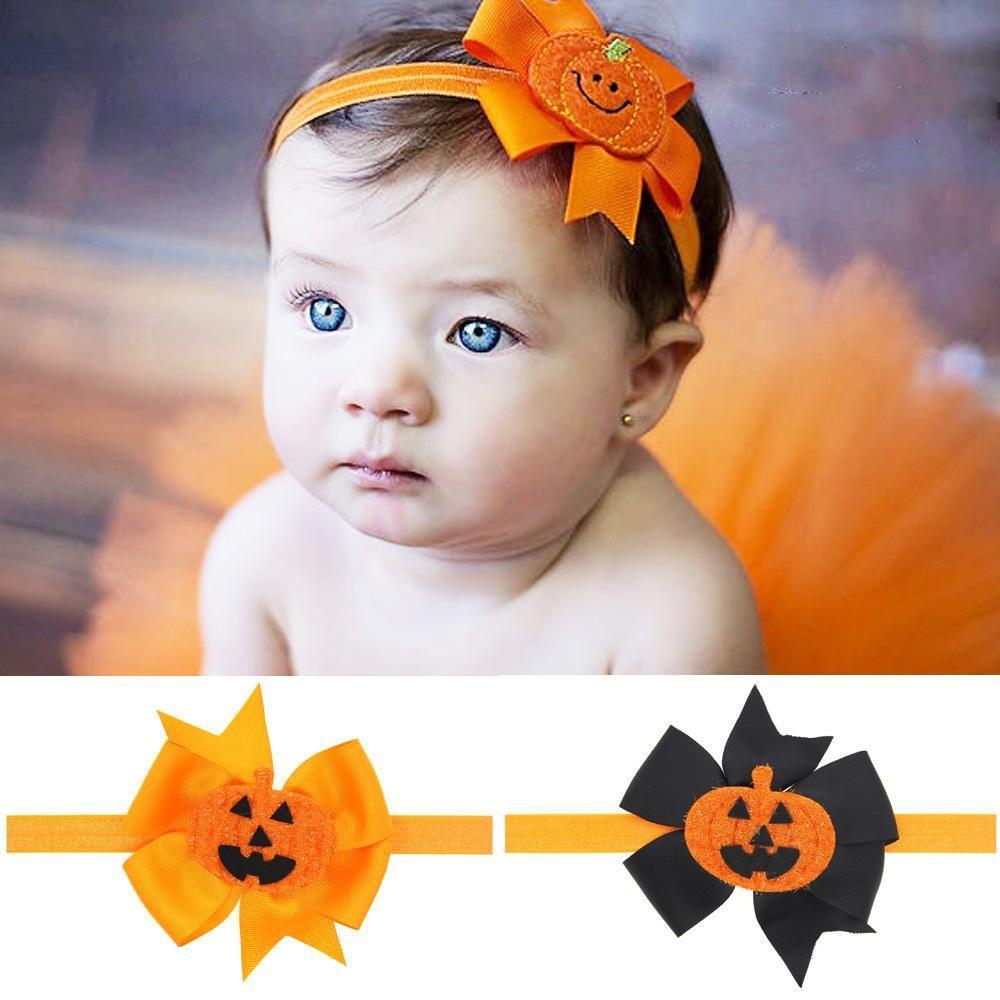 orange headband with pumpkins on