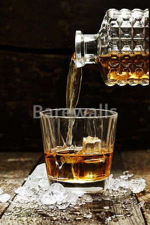 """""""Pouring Whiskey or Scotch from carafe into a glass with ice cubes"""" - Bar and Man Cave Decor available at Barewalls.com"""
