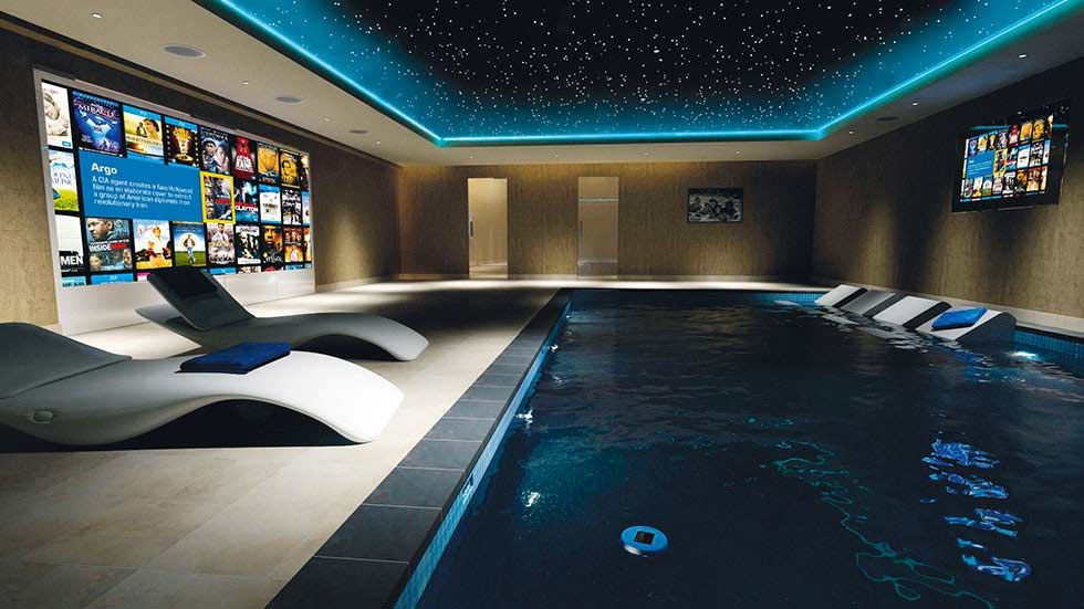 Indoor swimming pool with a home cinema room check more at for Swimming pool room ideas