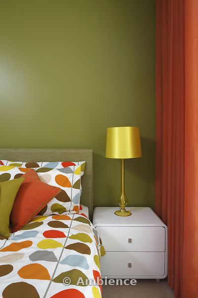 Olive green bedroom with orange curtains and Orla Kiely bedding ...