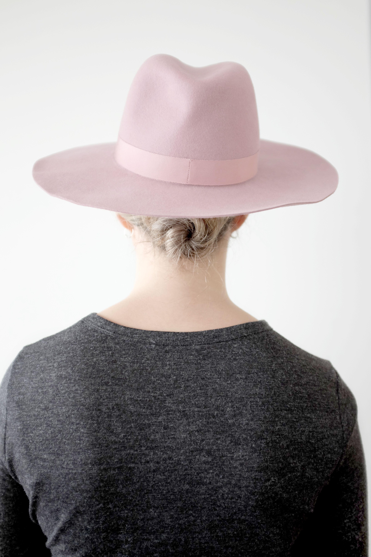 Rose blush wide-brim felt fedora with grosgrain trim.