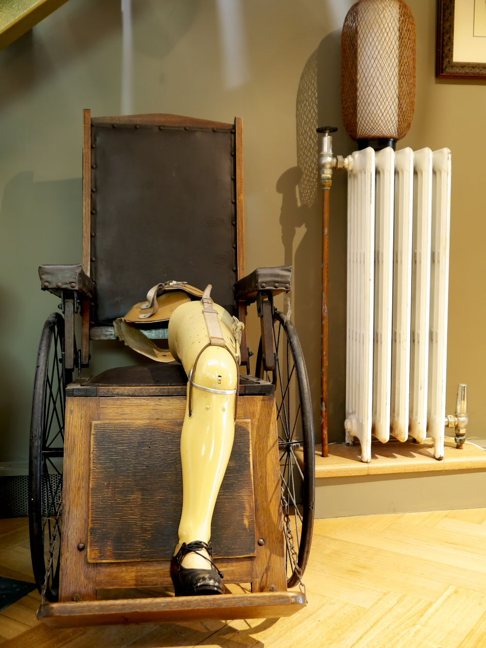 vintage prosthetic leg from the UK with 1920s wheelchair