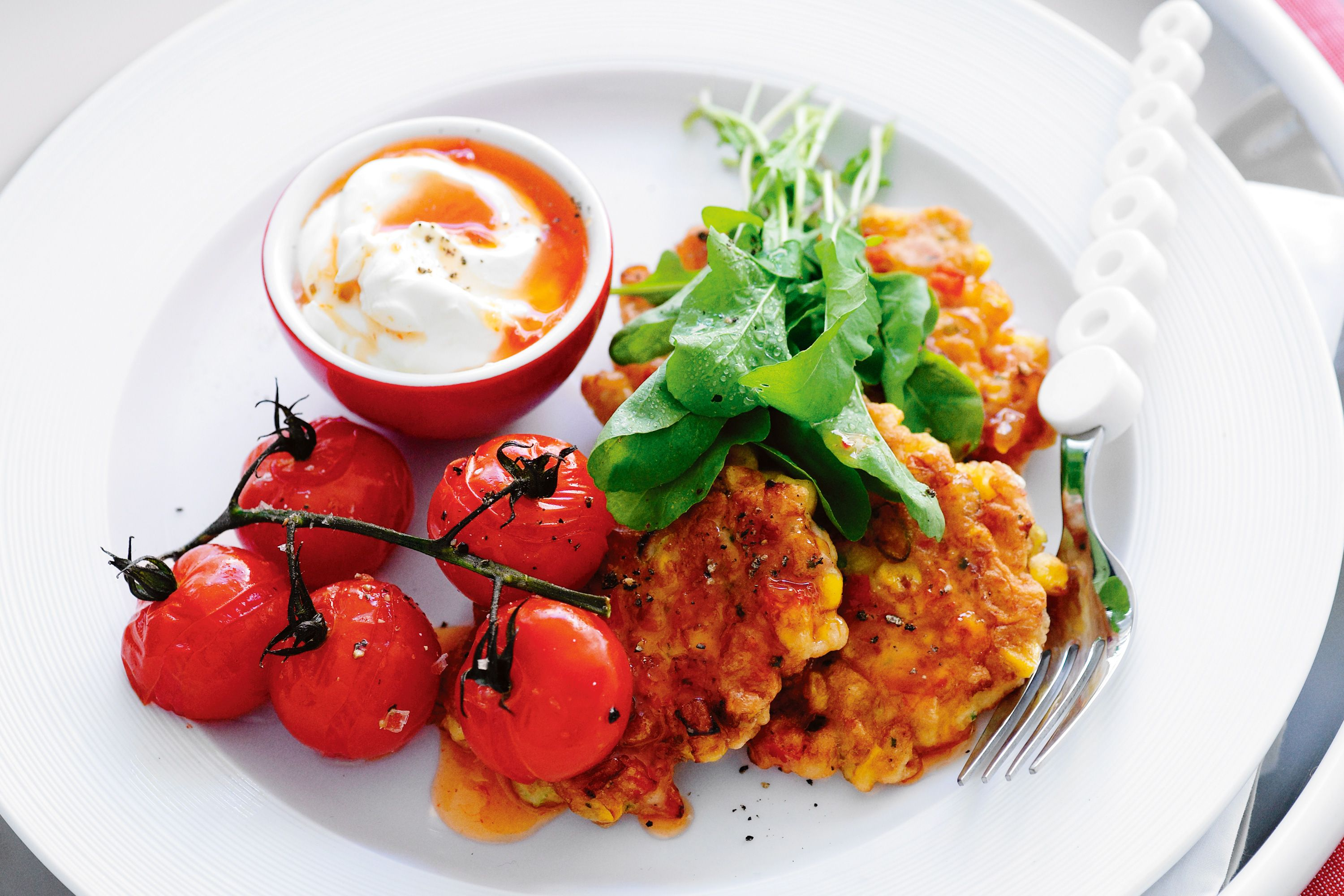 Corn and ham fritters with roasted cherry tomatoes recipe