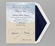 Your names and wedding date are drawn in the sand on this romantic beach themed invitation on felt paper.
