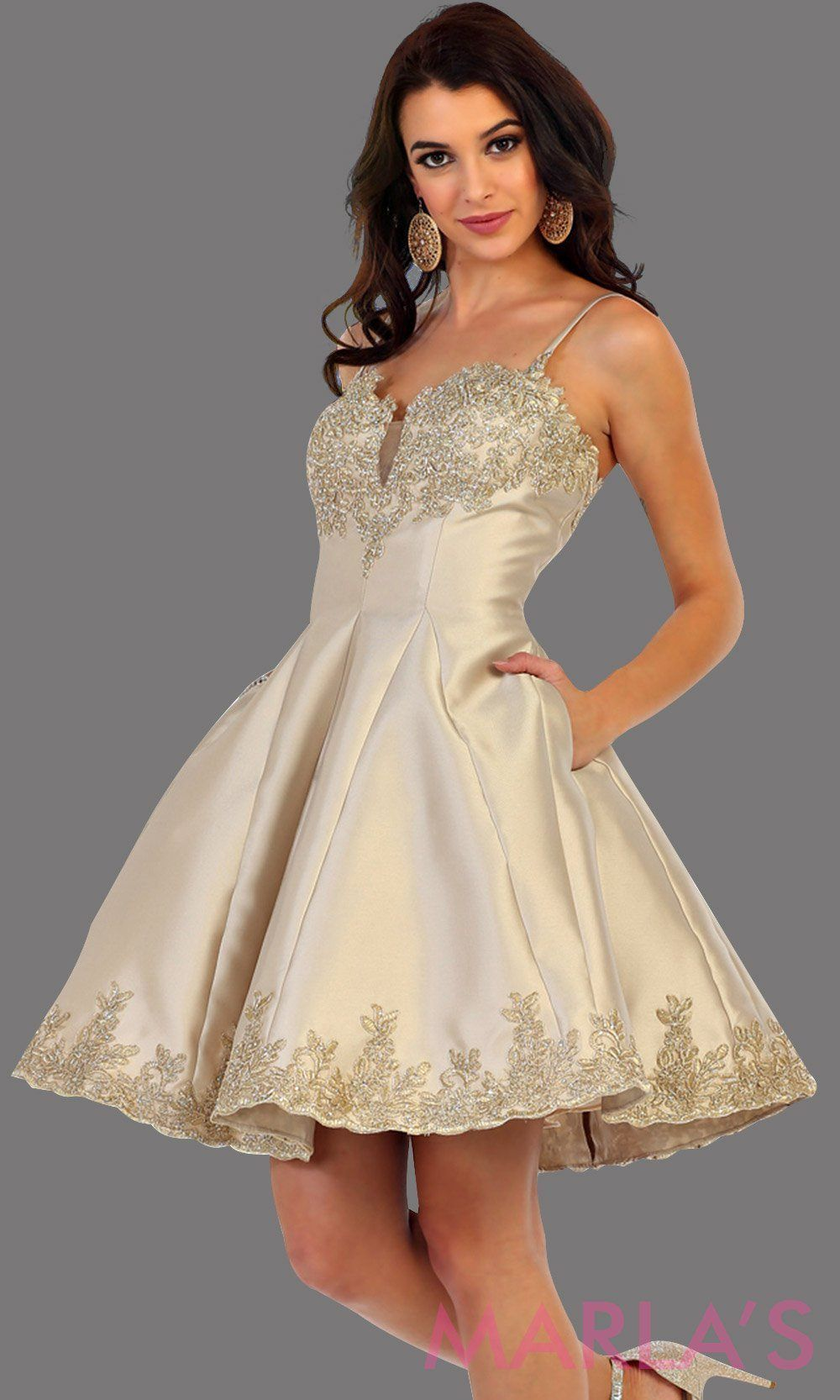 b2a7f288e49 Short satin champagne grade 8 graduation dress with gold lace detail and  straps. This dress features pockets. Perfect light gold short prom dress