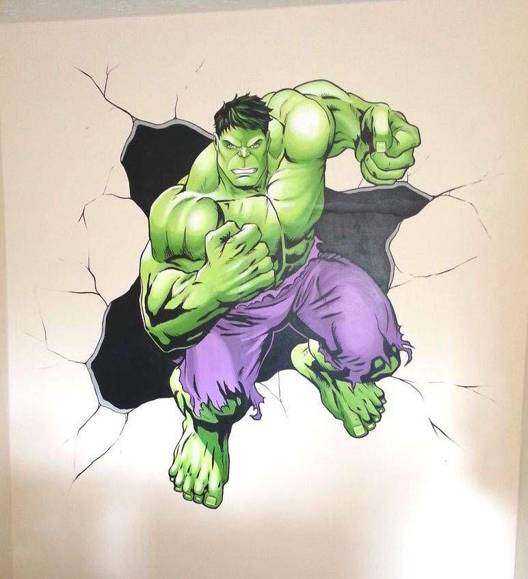 A mural of the The Incredible Hulk smashing through the ...