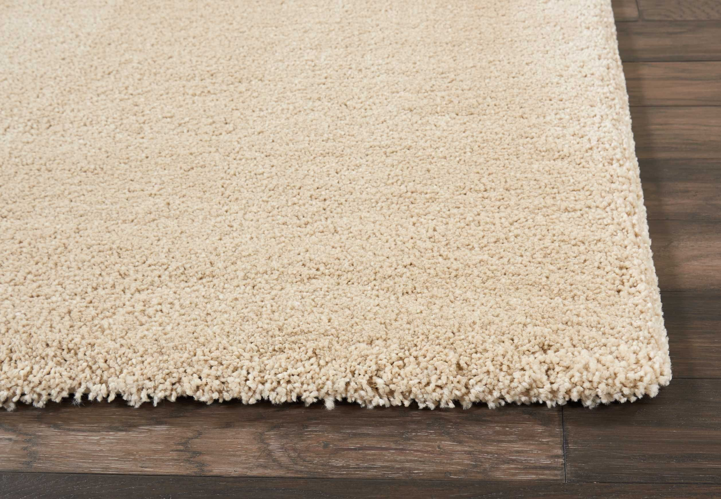 CK700 Beige This Greenpoint area rug by Calvin Klein