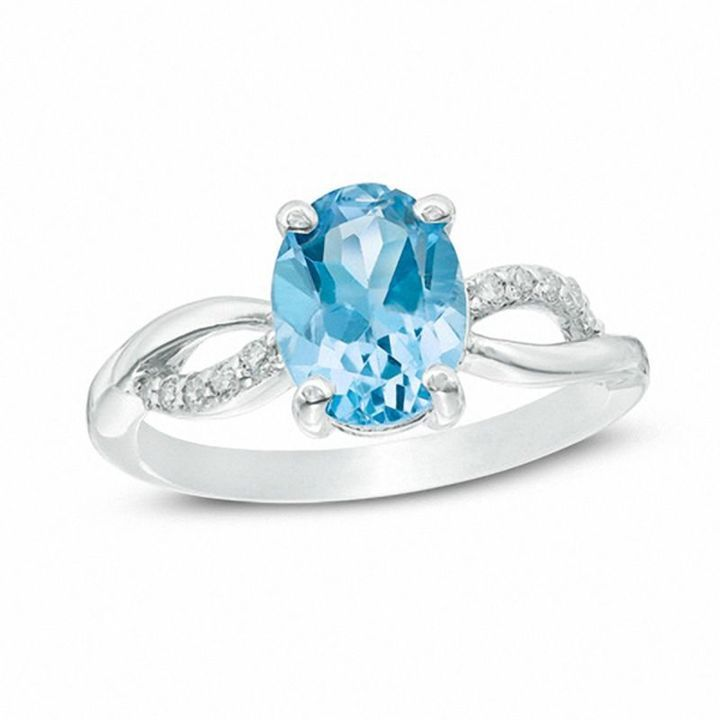 Zales Oval London Blue Topaz and 1/10 CT. T.w. Diamond Ring in Sterling Silver UIi7Jp