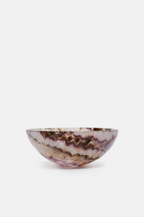 A gem of an accent piece. This bowl reveals the full shade range of amethyst. The purple-hued variety of crystalline quartz is thought to have…
