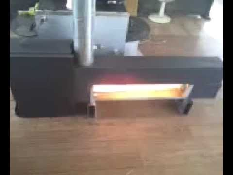 Wood gas rocket fire stove boiler youtube sustainable for Rocket fire heater