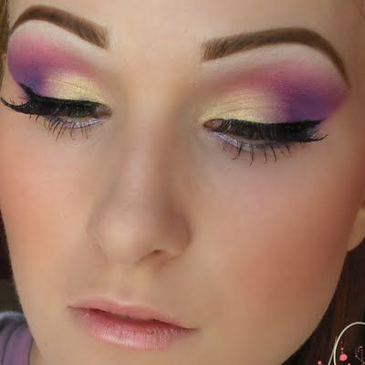 Spice up your look with this regal purple and gold smokey eye. Use three different shades of purple for some extra depth.