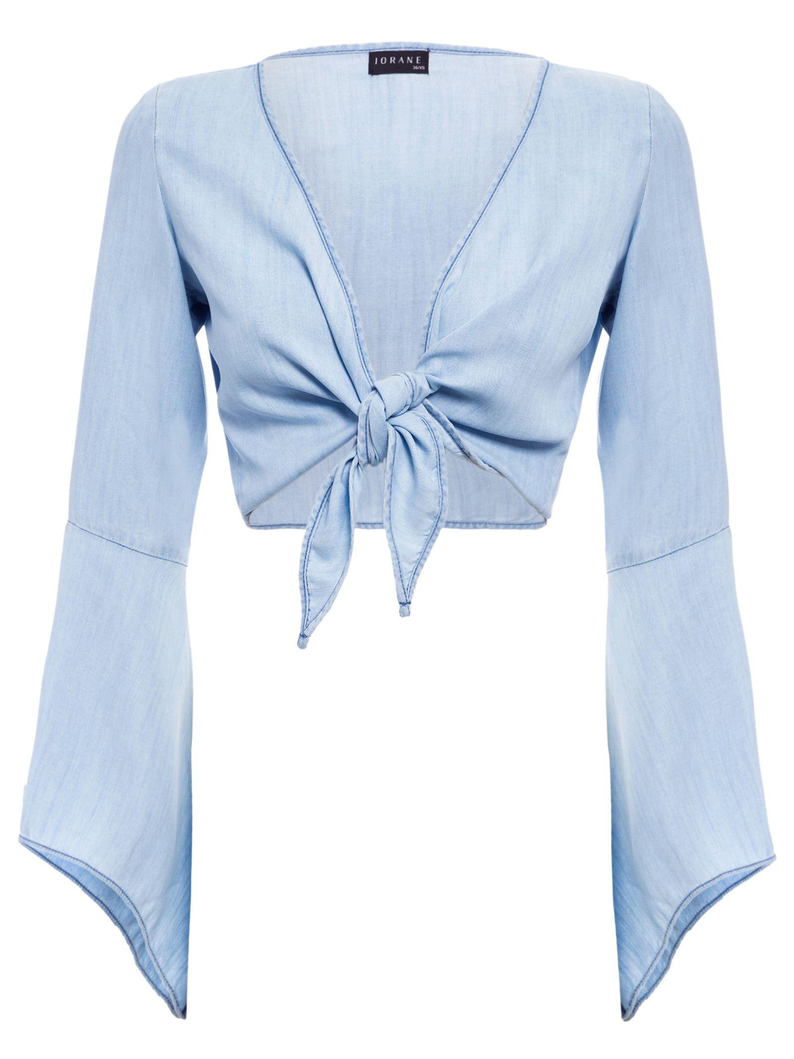 49e0a4edee A blusa azul Jeans De Amarrar é confeccionada em jeans e de modelagem  cropped. Esta peça possui decote V, mangas longas, fechamento por amarração  e detalhe ...