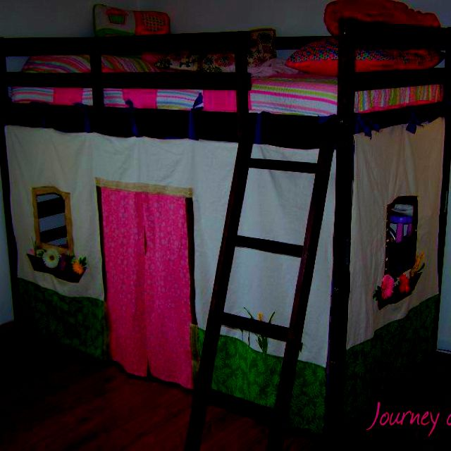 A bunk bed playhouse, separate fabric for door (maybe from extra side fabric).