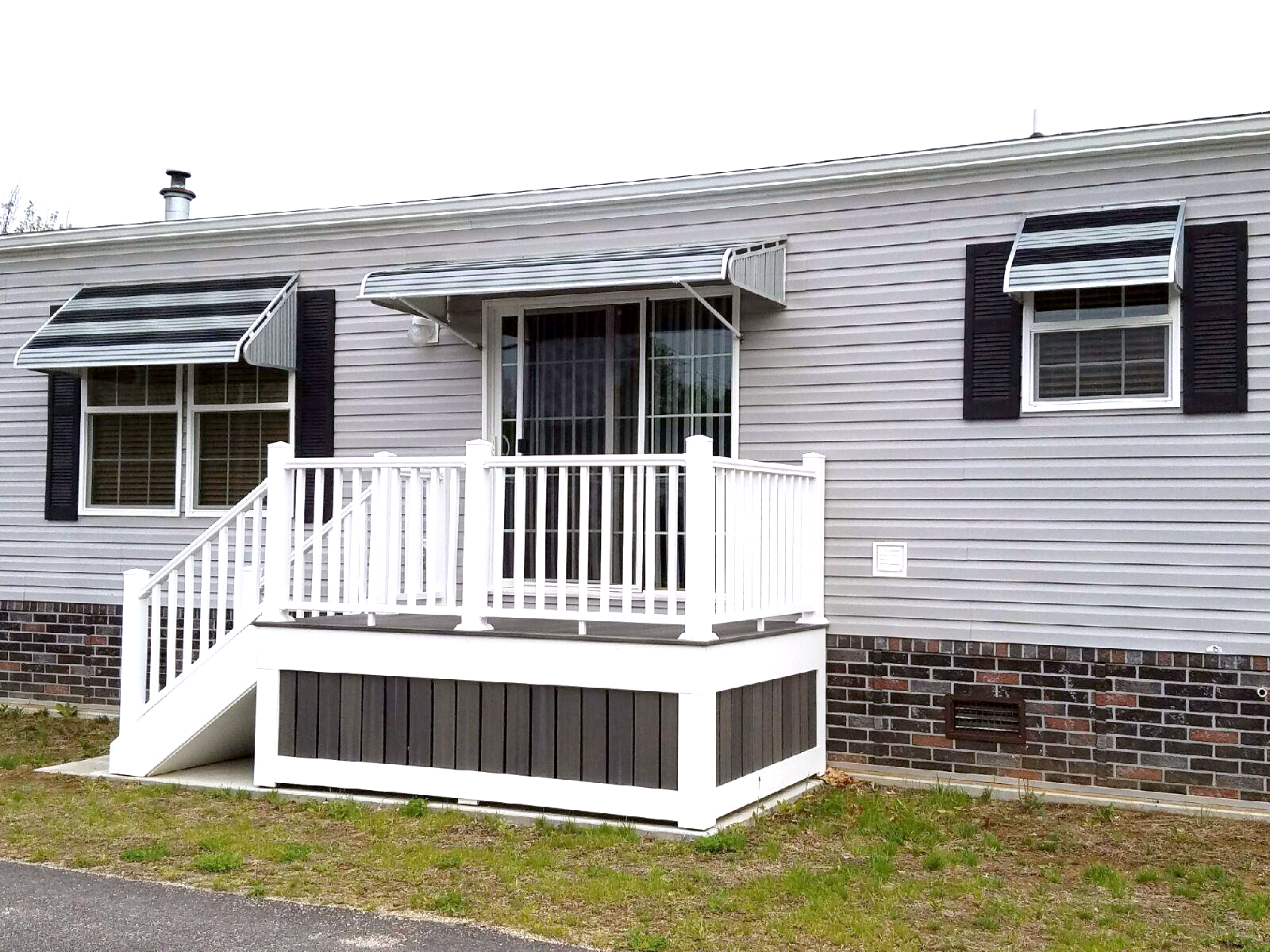 Shown Here Are Two Series 3500 Aluminum Window Awnings And A Series 1500 Aluminum Door Canopy By Nuimag Aluminum Awnings Aluminum Window Awnings Window Awnings